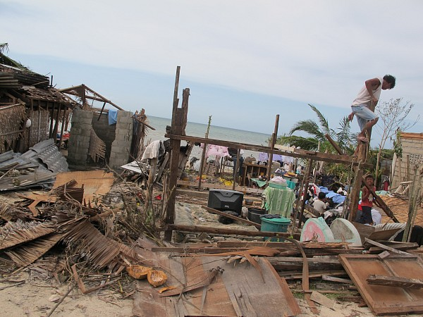 Survivors attempt to build a temporary shelter from debris after super-typhoon Yolanda devastated parts of the central Philippines. (Photo Credit: Moises Musico)