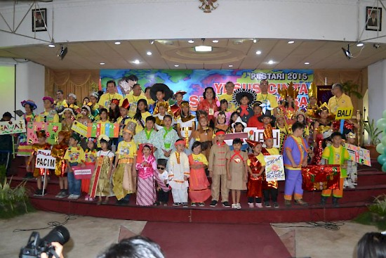 Children in west Java, Indonesia celebrate Christ's love during the Children%u2019s Spiritual Celebration at the Indonesian Adventist University on August 9. They represent the different countries of the world in their colorful international costumes. [photo courtesy of WIUM]