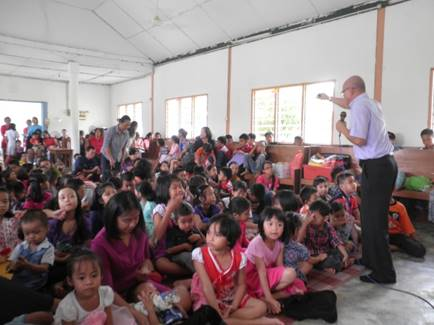Over 100 children sat on mats filling the floor of a church in Kampung Simboh, Malaysia during a Vacation Bible School uniquely held in the evenings with a separate evangelistic seminar organized for the adults on August 2-8. [photo courtesy of Joggery Gelu]