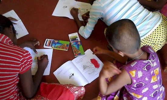 A children colors during an activity at the